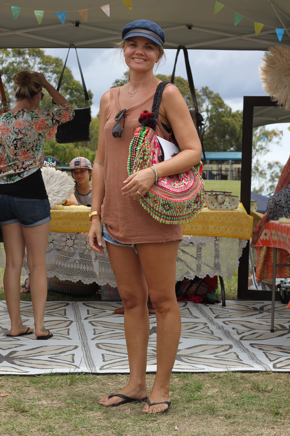 Kath was shopping up a storm at TVM on Sunday looking effortlessly stylish.  We loved her Miss Spent beaded bag and cute train driver style hat. a642e3ada0c